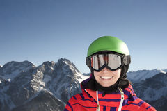 Young woman smiling at the camera. Young snowboarder smiling at the camera Stock Images