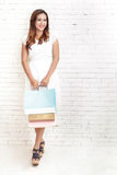 young woman smiling while carrying shopping bags Royalty Free Stock Photos