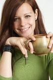 Young woman smiling with coffee Royalty Free Stock Photos