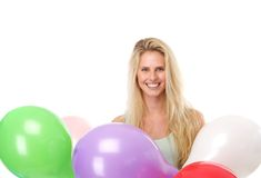 Young woman smiling with colorful balloons Stock Images