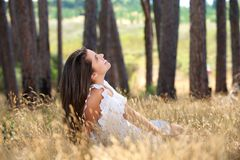 Young woman smiling in a countryside meadow Royalty Free Stock Image