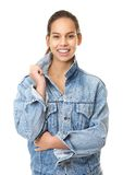 Young woman smiling in denim jeans jacket Royalty Free Stock Images