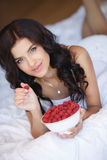 Young woman smiling eating fruit salad raspberry Stock Photography