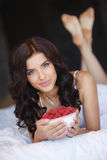 Young woman smiling eating fruit salad raspberry Royalty Free Stock Photography