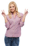 Young woman smiling while giving peace sign. Happy woman isolated on white Stock Images