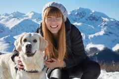 Young woman smiling with golden retriever pet friend Royalty Free Stock Image