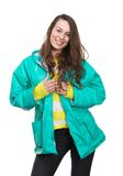 Young woman smiling with green raincoat Stock Photo