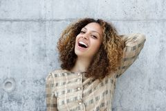 Young woman smiling with hand in hair Stock Photography