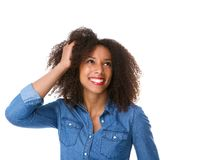 Young woman smiling with hand in hair Royalty Free Stock Photo