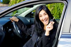 Young woman smiling happy about new car Stock Image
