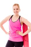 Young woman smiling with her arms akimbo Royalty Free Stock Photo
