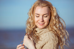 A young woman is smiling with her eyes closed royalty free stock image