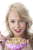 Young Woman Smiling Holding Bowl of Breakfast Cereals Stock Images