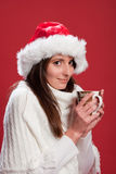 Young woman smiling holding a cup of hot chocolate Stock Photo