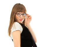 Young woman smiling and holding glasses Stock Photo