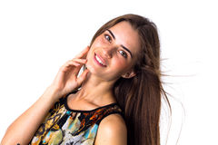 Young woman smiling and holding hand at her cheek Stock Photo