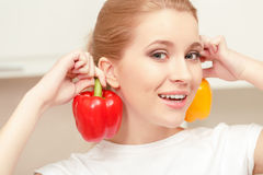 Young woman smiling and holding pepper Stock Images