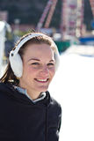 Young Woman Smiling At An Ice Rink Stock Images
