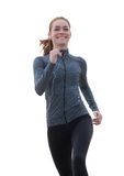 Young woman smiling and jogging outdoors Stock Photography