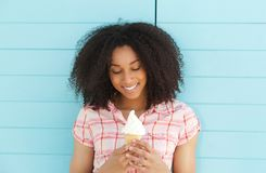 Young woman smiling and looking ice cream Royalty Free Stock Photos
