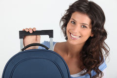 Young woman smiling with luggage Stock Photo