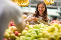 Young woman smiling at market Royalty Free Stock Photo