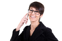 Young woman smiling at the mobile phone Stock Photography