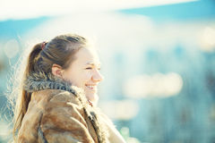 Young woman smiling outdoors Royalty Free Stock Photos