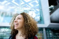 Young woman smiling outside stock photos
