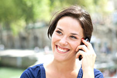 Young woman smiling on the phone Stock Image