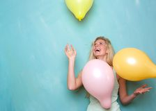 Young woman smiling and playing with balloons Stock Photo