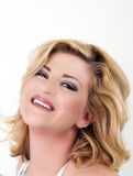 Young woman smiling portrait head tilted back Royalty Free Stock Images