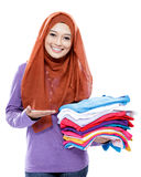 Young woman smiling and presenting clean clothes after ironing Royalty Free Stock Photo