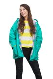 Young woman smiling with raincoat Stock Images