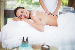 Young woman smiling while receiving spa treatment Royalty Free Stock Photography