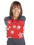 Young Woman Smiling with red gift bag Royalty Free Stock Image