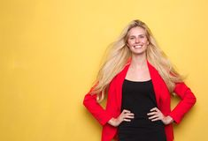 Young woman smiling in red jacket Royalty Free Stock Photography