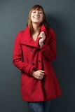 Young woman smiling in red winter jacket Stock Photo