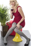 Young Woman Smiling Relaxing with Glass of Red Wine Royalty Free Stock Images
