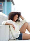 Young woman smiling and relaxing outdoors Royalty Free Stock Photo