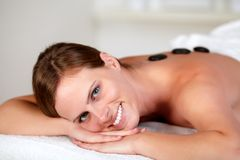 Young woman smiling and relaxing at spa Stock Images