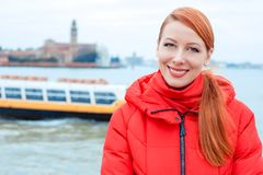 Young woman smiling sea and liner or ferry on the background stock image