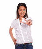 Young woman smiling and showing you victory sign Stock Image