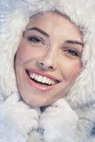 Young woman smiling, snowy day Royalty Free Stock Photos