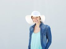 Young woman smiling with sun hat Stock Photo