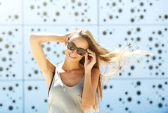 Young woman smiling with sunglasses Stock Images