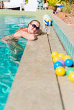 Young woman smiling in a swimming pool Royalty Free Stock Photo