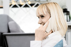 Young woman smiling and talking on a mobile phone Royalty Free Stock Image