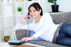 Young woman smiling and talking on the phone Stock Images