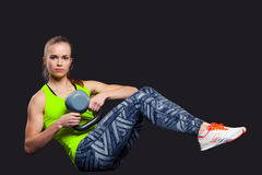 Young woman smiling while using kettlebells Stock Image